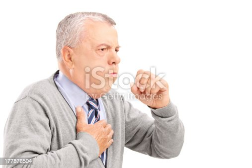 istock A mature man with gray hair coughing into his hand 177876504