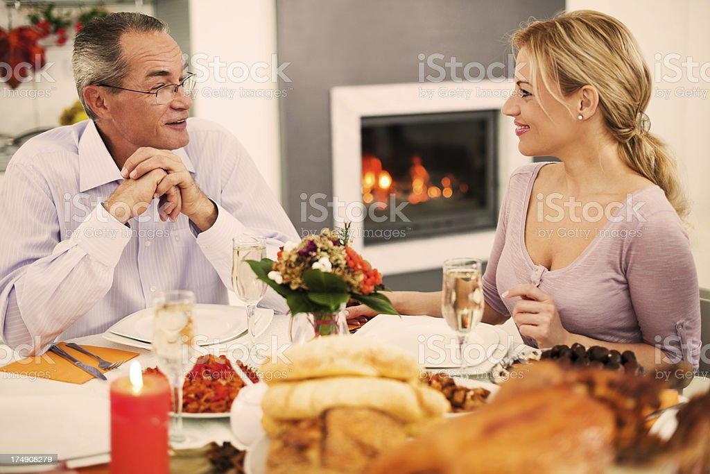 Mature man with his adult child on a Thanksgiving day. royalty-free stock photo