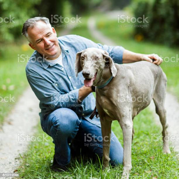 Mature man with his dog picture id870219566?b=1&k=6&m=870219566&s=612x612&h=uwukspi3ui6m em8macag5tgb0zxavk9rdwqhvbrew4=