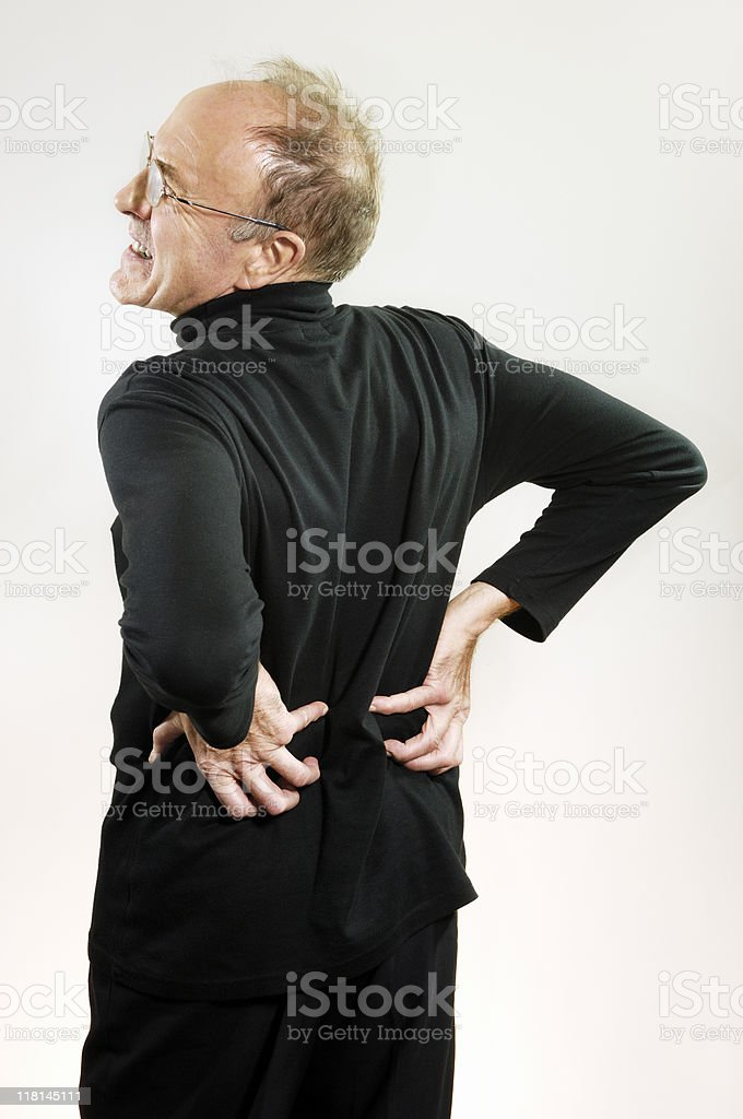 Mature man with lower back pain royalty-free stock photo