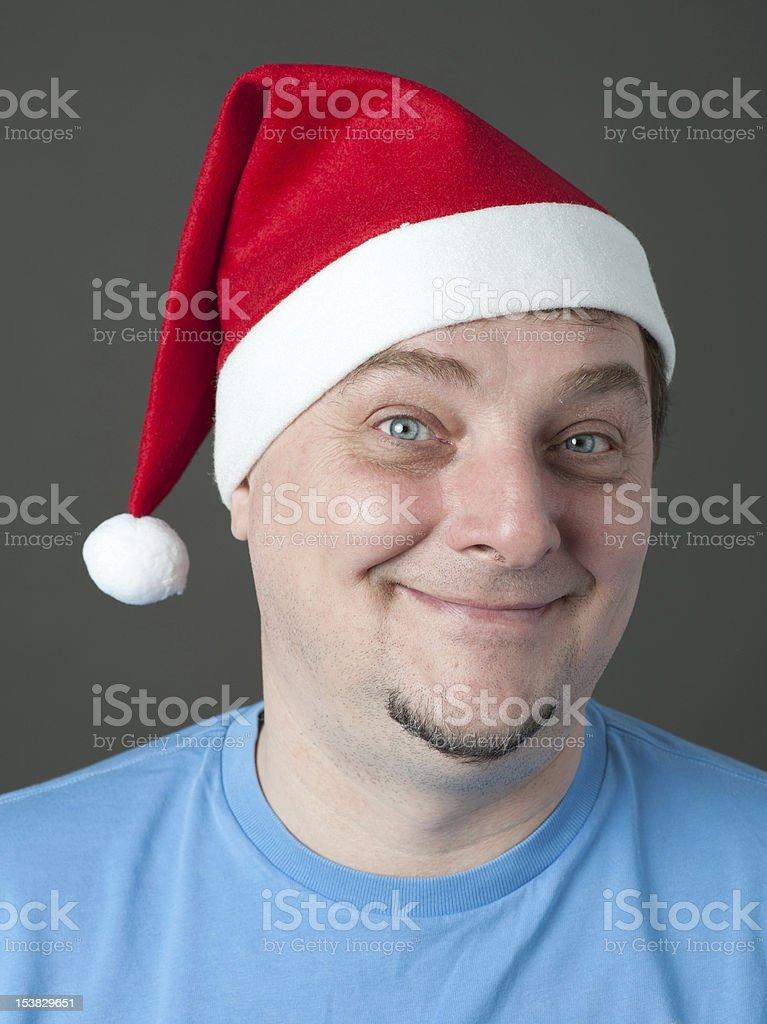Reifer Mann mit Weihnachtsmütze – Foto