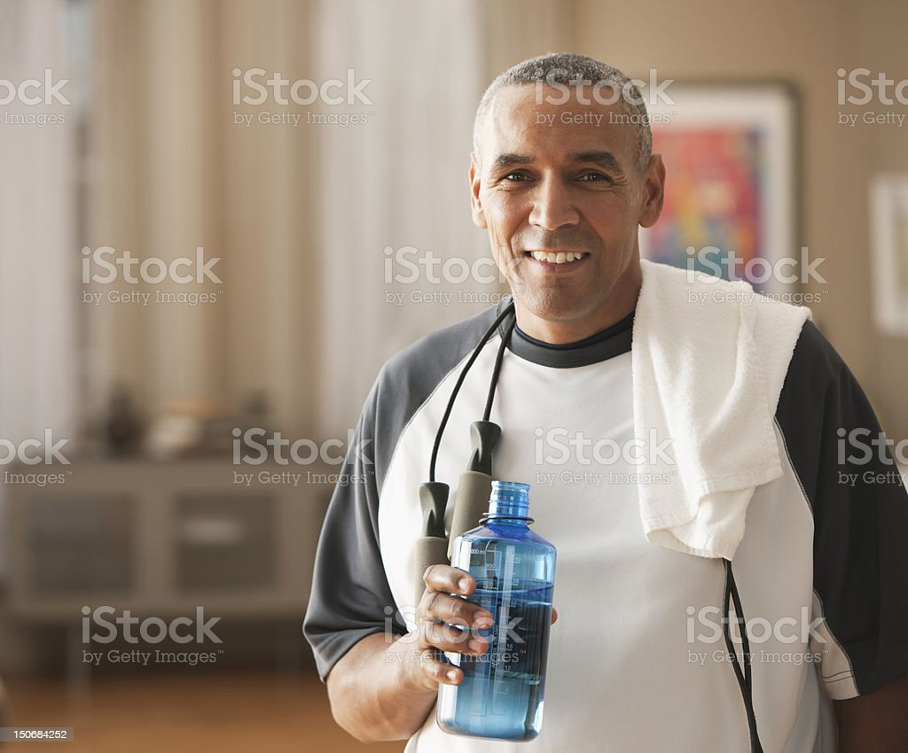 Mature man with water  bottle after workout stock photo