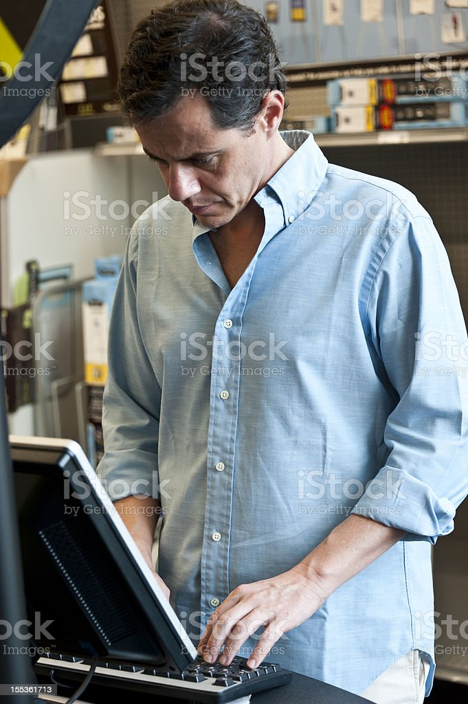 mature man working at his store royalty-free stock photo