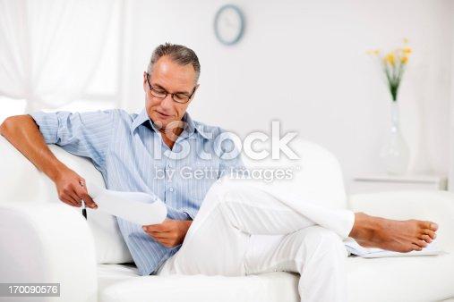 530281733istockphoto Mature man working at home. 170090576
