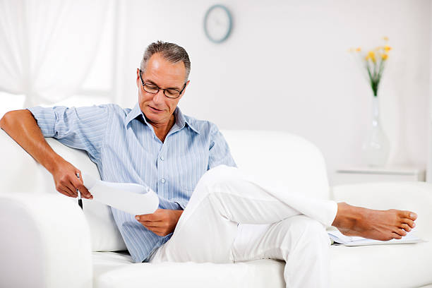 Mature man working at home. stock photo