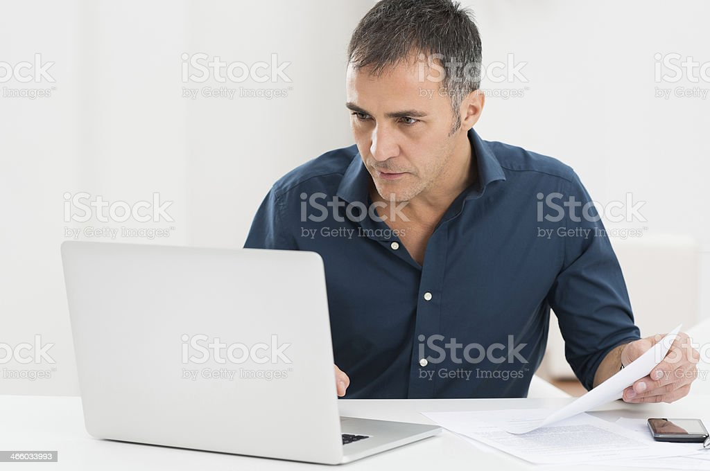 Mature Man Working At The Computer stock photo
