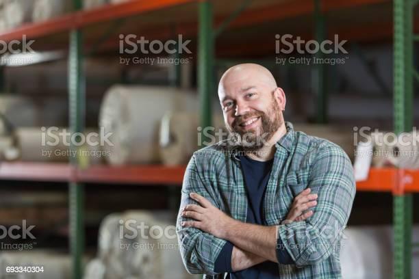 Mature man working in carpet warehouse picture id693340304?b=1&k=6&m=693340304&s=612x612&h=ssnzajt yax y91lryq9t9k cqunjtvcmi9m41zfupo=