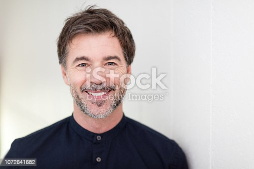 637538262istockphoto Mature Men Smiling, Isolated On White 1072641682