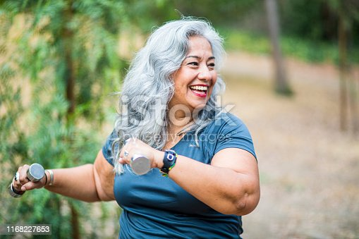 851958232 istock photo Mature Mexican Woman Working Out 1168227653