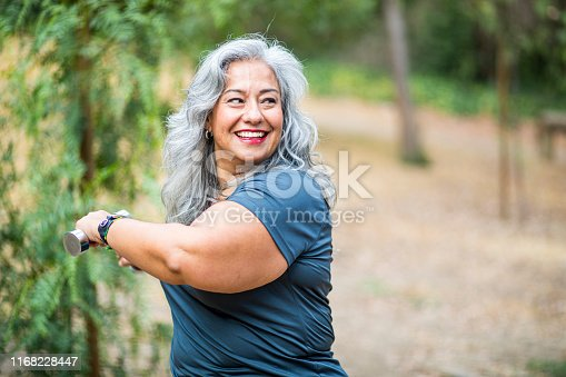 851958232 istock photo Mature Mexican Woman Working Out 1168228447
