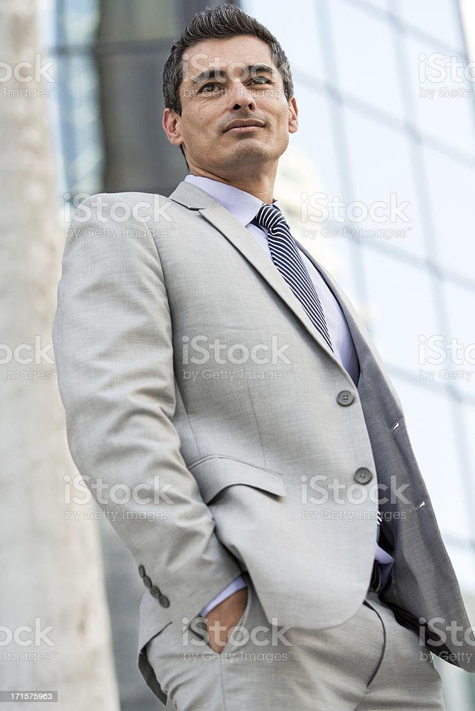 Mature middle aged male businessman smiling in grey suit royalty-free stock photo
