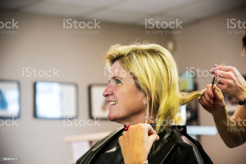 Mature Middleaged Woman In A Hair Salon Discussing Her Hair Style