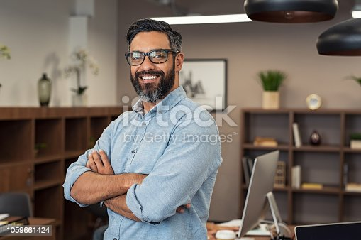 istock Mature mixed race business man 1059661424