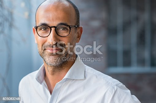 istock Mature mixed race man smiling 825083248