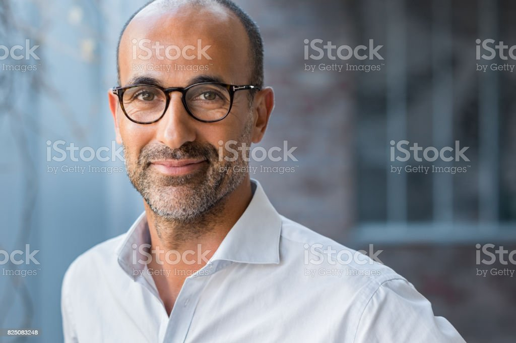 Mature mixed race man smiling stock photo