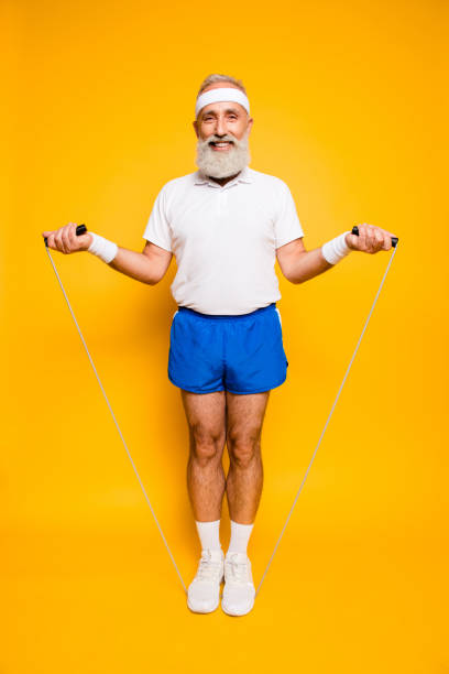 mature modern cool cheerful, confident pensioner grandpa champion. bodycare, healthcare, weight loss, pride, strength, leadership, motivation, happiness lifestyle - old man feet stock photos and pictures