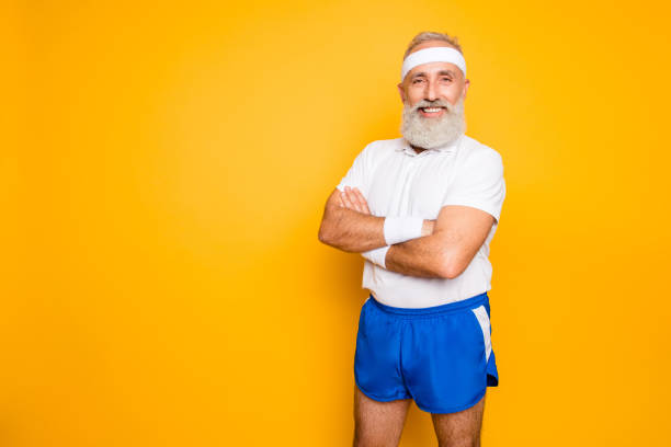 Mature modern cool grey haired macho competetive pensioner grandpa, leader, champion. Bodycare, healthcare, weight loss, pride, strength, leadership, motivation, advertising, happiness lifestyle stock photo