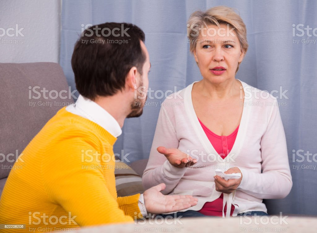 Mature mother and son quarrel stock photo