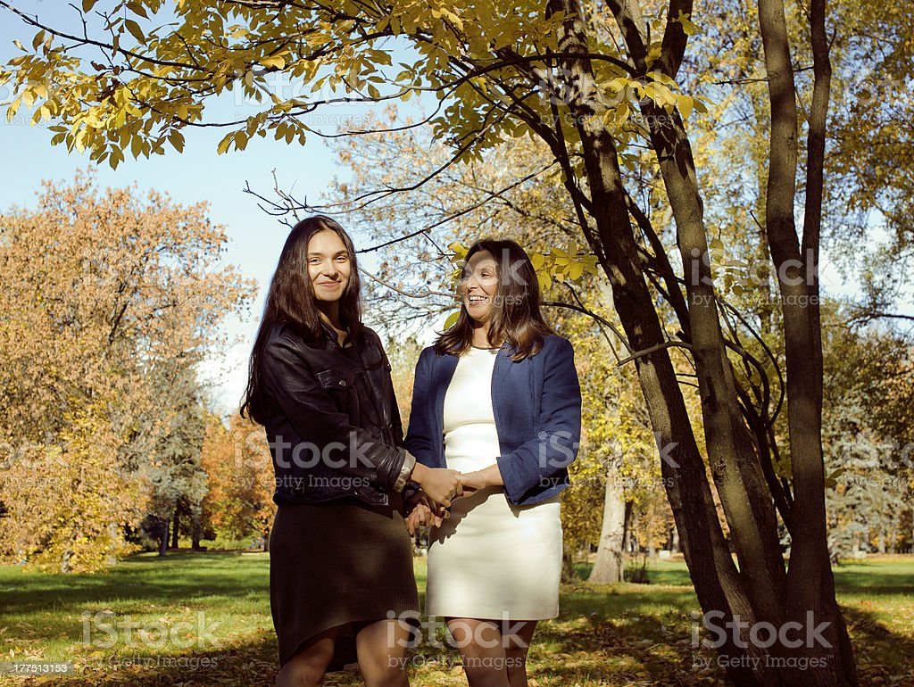 mature mother with daughter outside royalty-free stock photo