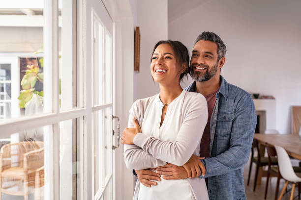 Mature multiethnic couple thinking about their future family stock photo