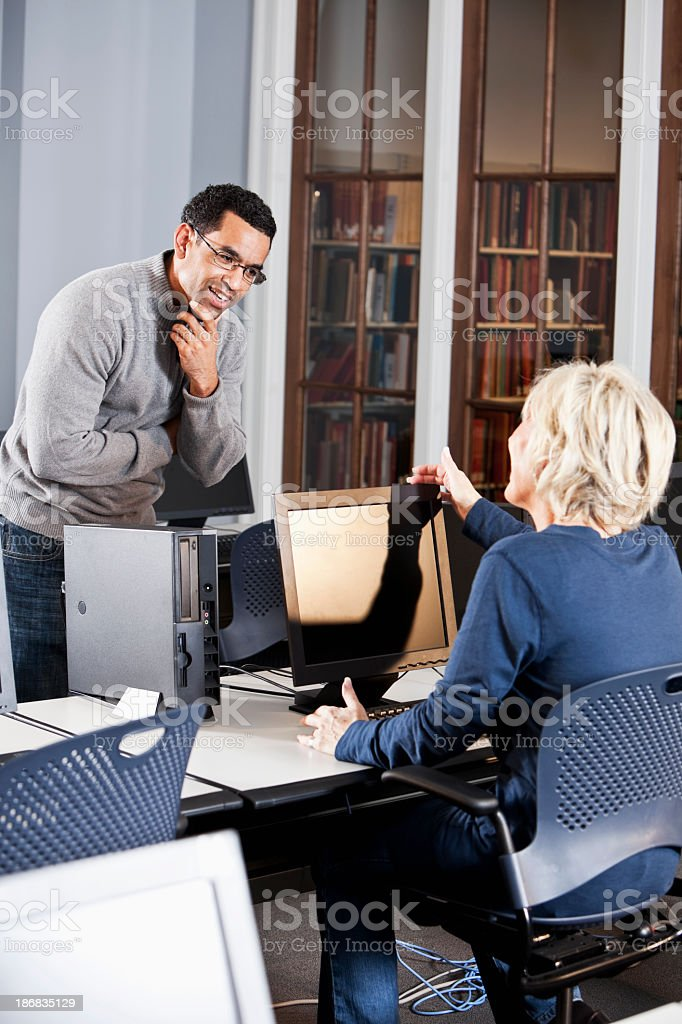 Mature multiracial office workers having discussion stock photo