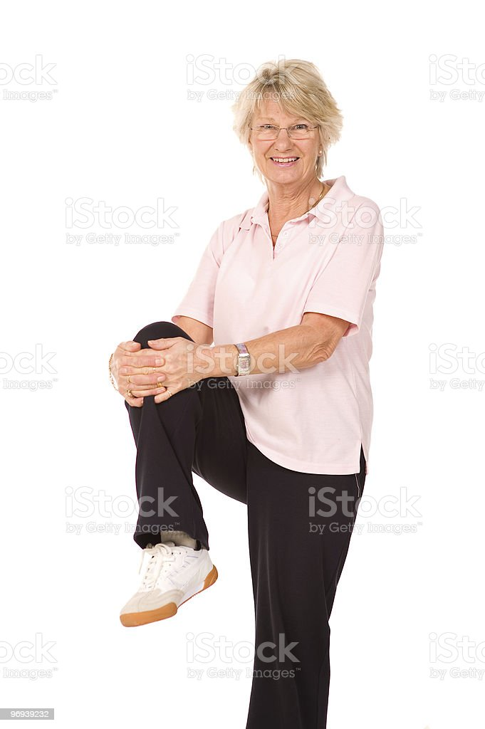 Mature older lady stretching royalty-free stock photo