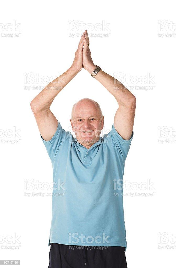 Mature older man doing yoga royalty-free stock photo