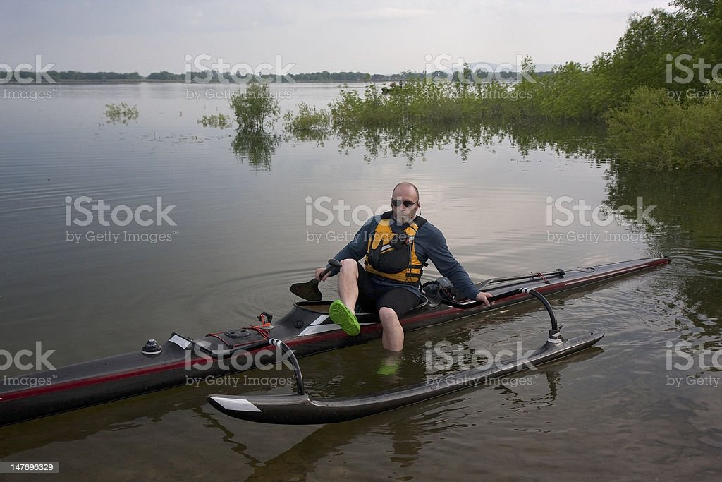 mature paddler in racing outrigger canoe royalty-free stock photo