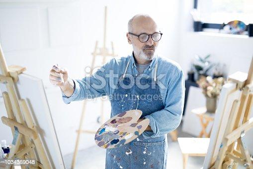 istock Mature painter 1034369048