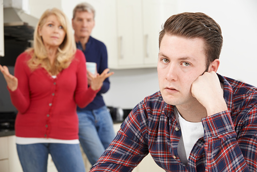 istock Mature Parents Frustrated With Adult Son Living At Home 471526038