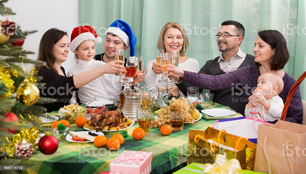 Mature parents with kids celebrating Merry Christmas royalty-free stock photo