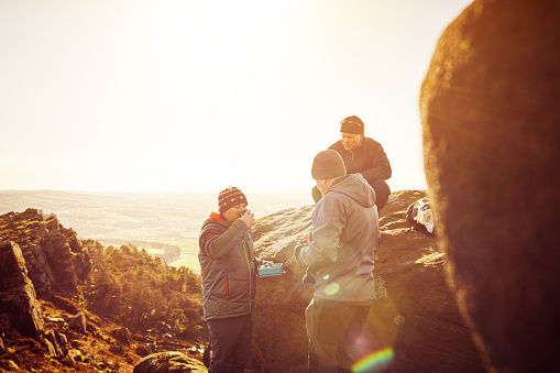 Mature people having a rest at top of mountain