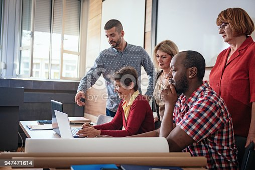 876965270 istock photo Mature people learning how to use social media networks 947471614