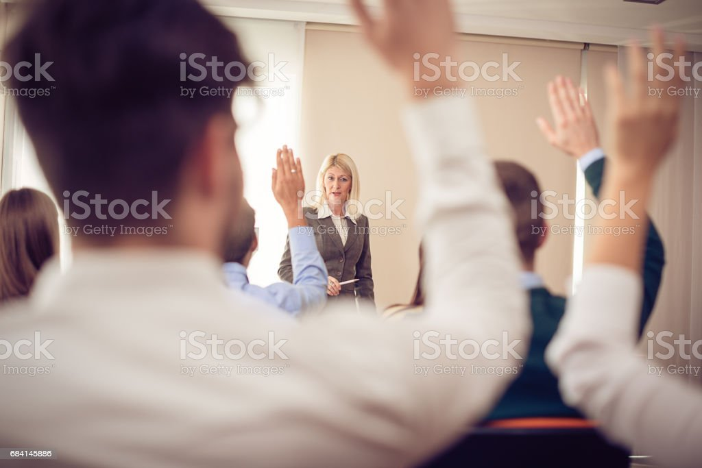 Mature professor and students royalty free stockfoto