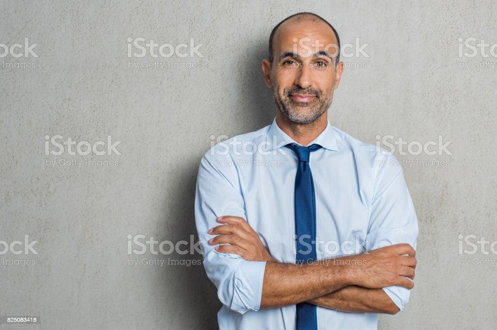Mature proud businessman stock photo