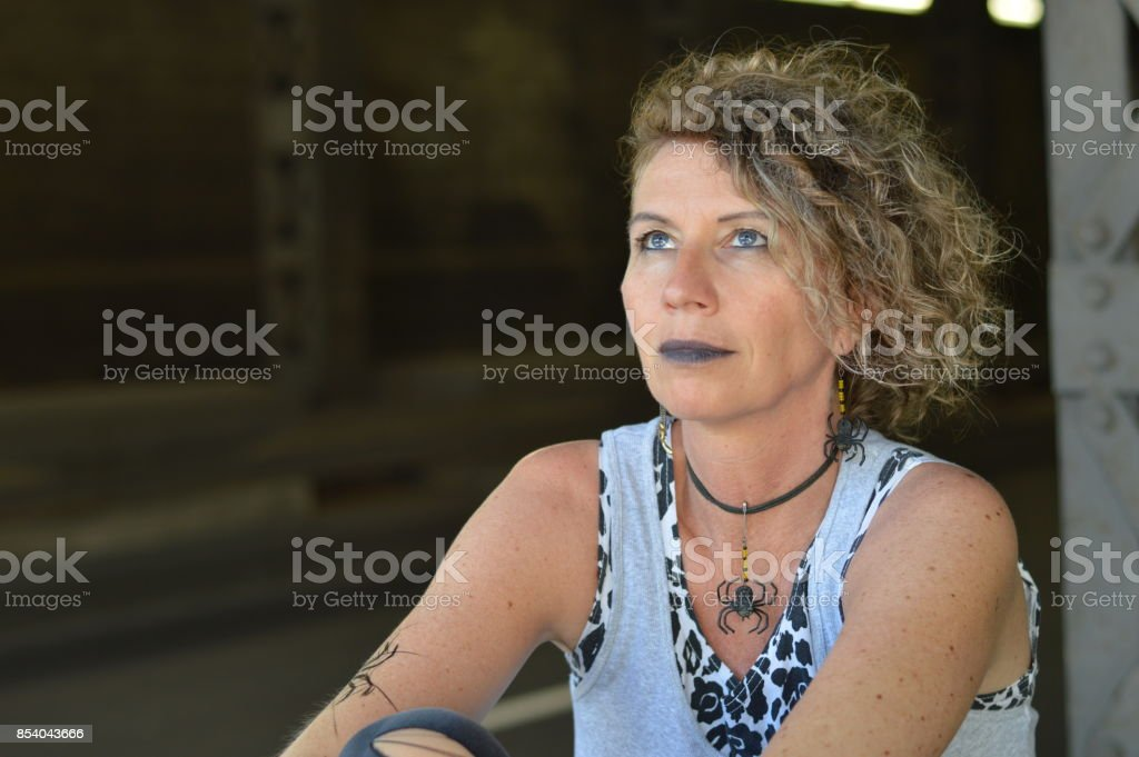 mature punk lady looking to the sky stock photo