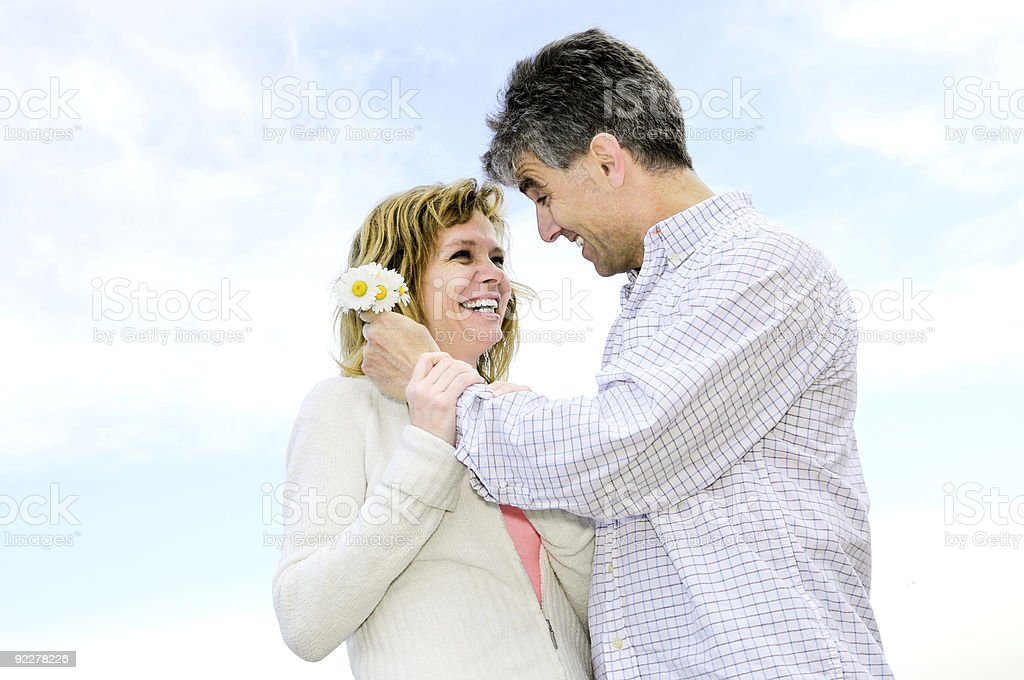 Mature romantic couple with flowers royalty-free stock photo