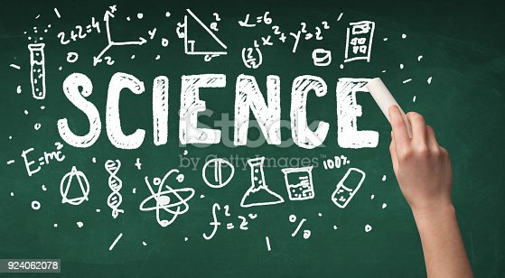 istock Mature science person drawing on board 924062078