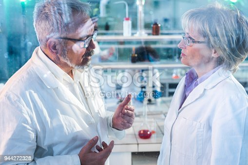 499203366istockphoto Mature scientists discussing about research while working in laboratory. 944272328
