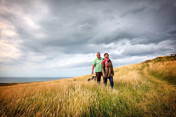 Mature senior couple walking on coastal headland with sheepdog picture id486508538?b=1&k=6&m=486508538&s=612x612&w=0&h=s1x1 wton6eaiw1pzhajrpbzupmihswfvjes9mrmi2i=