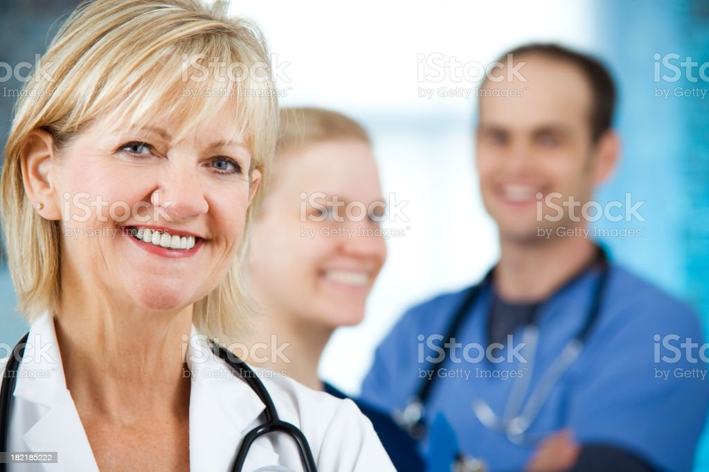 Mature Senior Doctor or Physician Health Care Professional Team stock photo