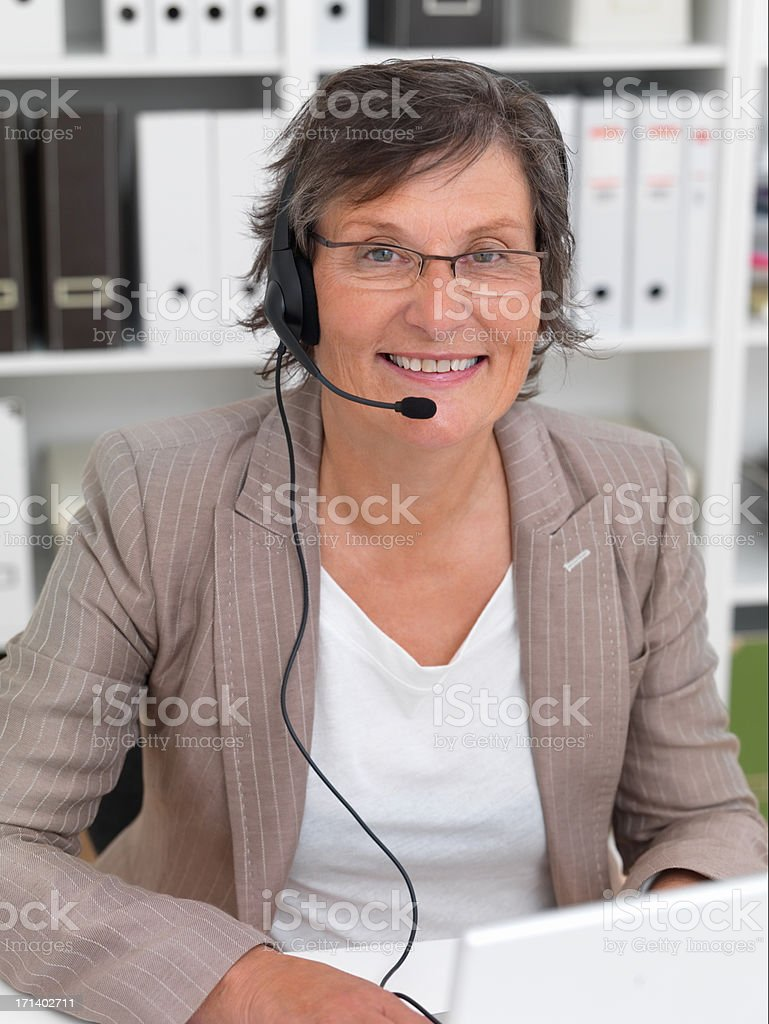 Mature service woman working in office royalty-free stock photo