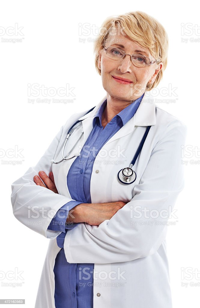 Mature Smiling Female Doctor, Studio Portrait Portrait of a mature female doctor standing with arms crossed and smiling at camera. Studio shot on a white background. 60-64 Years Stock Photo