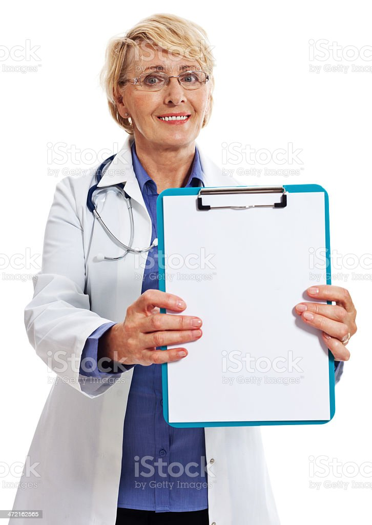 Mature Smiling Female Doctor, Studio Portrait Portrait of a mature female doctor showing a clipboard at the camera. Studio shot on a white background. 60-64 Years Stock Photo
