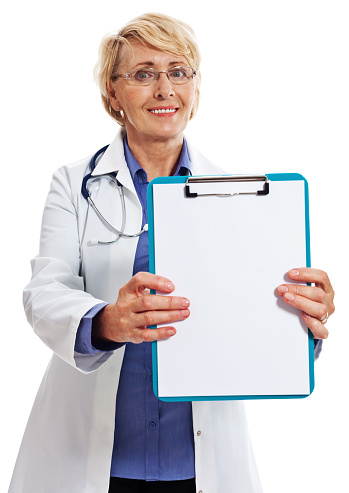 Mature Smiling Female Doctor Studio Portrait Stock Photo - Download Image Now