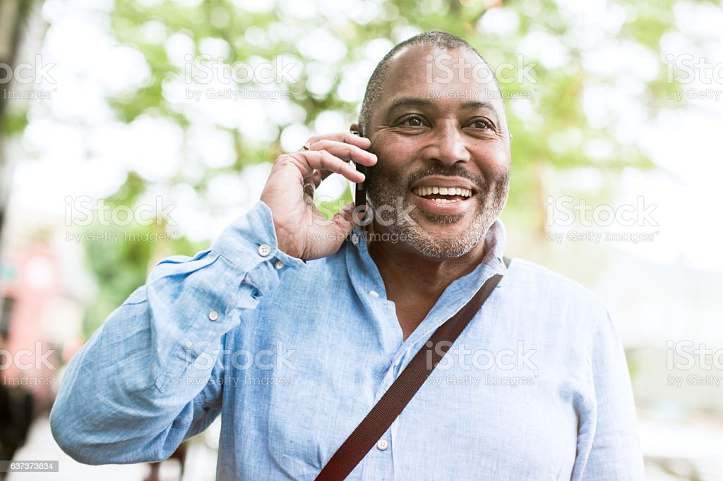 Mature Smiling Man Outdoors stock photo