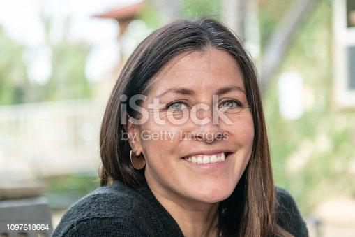 825083310 istock photo Mature smiling woman 1097618664