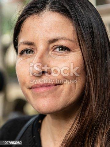 825083310 istock photo Mature smiling woman 1097650980