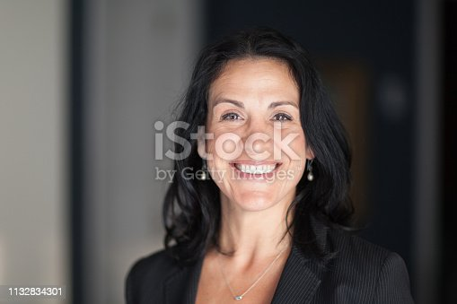 625010932istockphoto Mature Spanish Businesswoman Smiling At The Camera. At The Office. She is so confident 1132834301