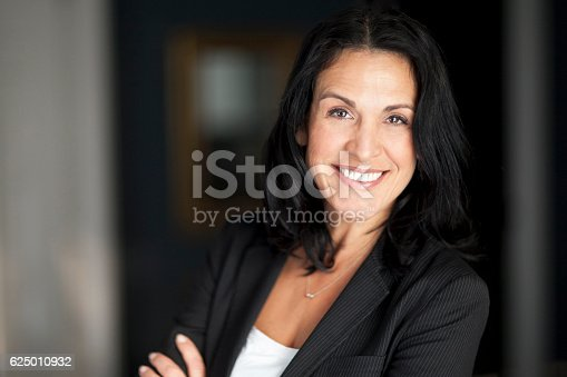 625010932istockphoto Mature Spanish Businesswoman Smiling At The Camera. 625010932